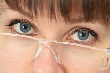 Women look over spectacles close up