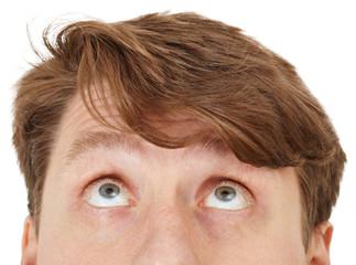 Eyes of man look upwards, close up