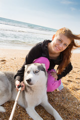 woman with husky dog selfie at sea