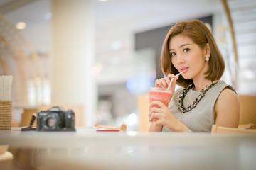 Travel tourist woman on vacation,Drinking watermelon juice smoot