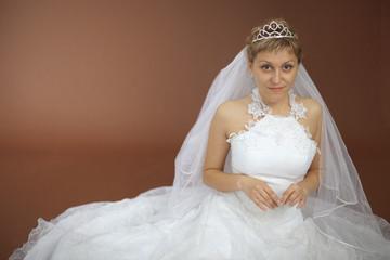 Beautiful amusing bride in white dress