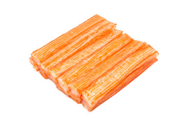 Imitation crab sticks on white background.
