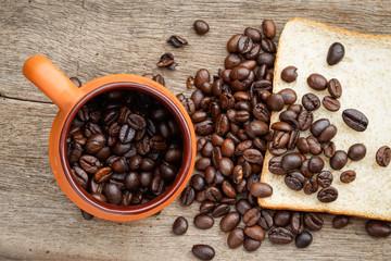 Coffee bean on the wooden floor