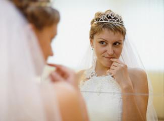 Bride admires himself in mirror
