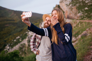 Couple taking a selfie at mountain.