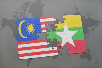 puzzle with the national flag of malaysia and myanmar on a world map background.