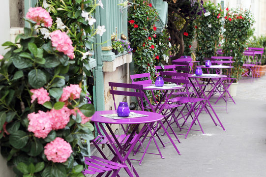 Paris street cafe with bright tables.