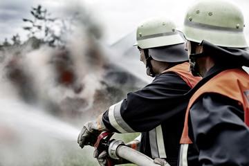 Fire brigade extinguishing fire