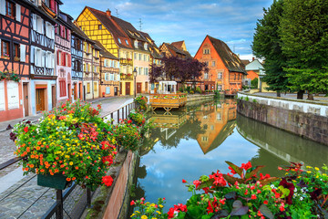 Colorful medieval half-timbered facades reflecting in water,Colmar,France