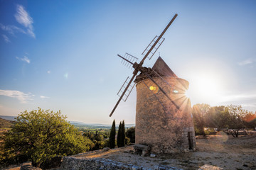 Garden Poster Mills Old stone windmill against sunset in Saint Saturnin les Apt, Provence, France