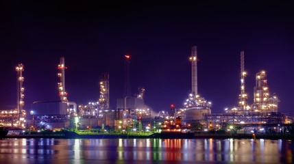 Oil refinery / Oil refinery reflex on river at twilight.