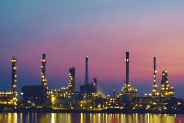 Oil refinery / Oil refinery reflex on river at twilight.