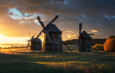 Old wooden windmill in autumn evening. Ukraine