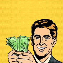 Successful businessman man holds money in hands pop art