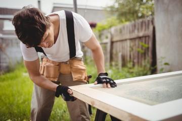 Carpenter working on a door frame