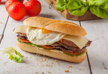 Chivito, a typical sandwich from Uruguay with beef, bacon, cheese and egg.