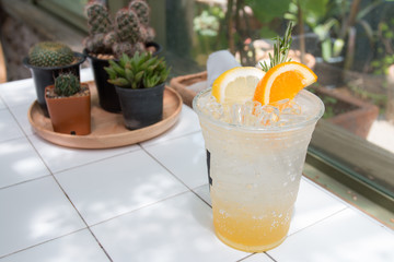 Iced lemonade soda in coffee cafe.