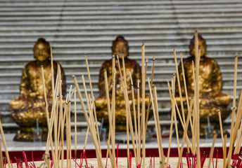 incense to the Buddha image