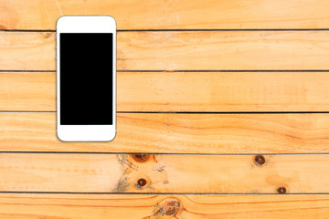 Top view smartphone mock up template with black screen on wooden table with copyspace.