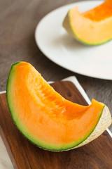Fresh melon on a wooden board