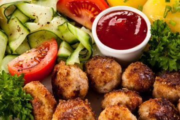 Roast meatballs, French fries and vegetable salad