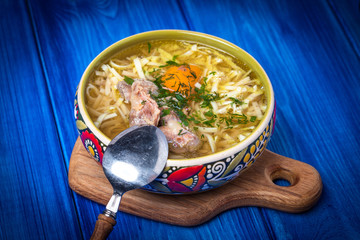 Soup with noodles and chicken.