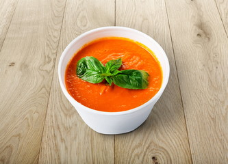 Hot food delivery - tomato gazpacho soup at wood