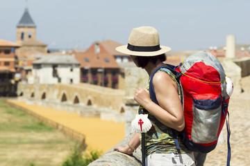 pilgrim woman in the Hospital de Orbigo bridge  , Way of St James,  Camino de  Santiago, to Compostela, Leon, Spain Wall mural