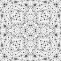 Monochrome abstract seamless kaleidoscopic floral background, texture or tile pattern.