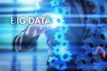 """Businessman is selecting """"Big data"""" on the virtual screen."""