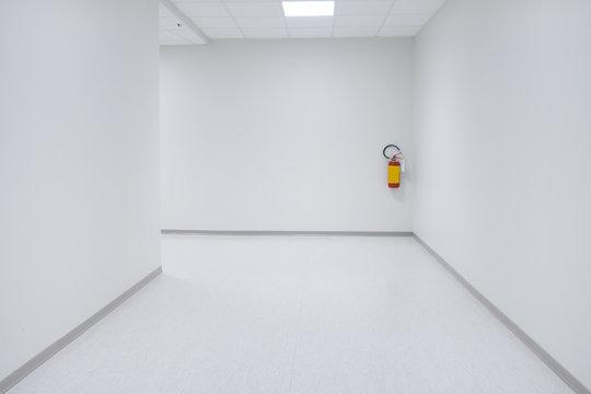Empty white corridor background with doors