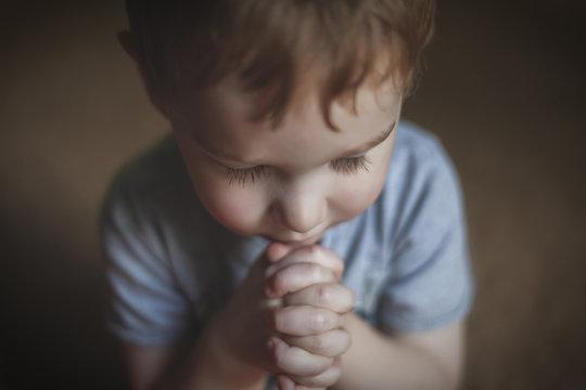 Cute Young Boy Praying