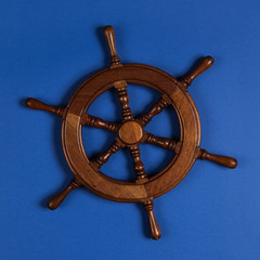 steering wheel of boat. Isolated over blue background