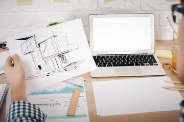 Architect evaluating project mockup
