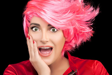 Surprised or flattered woman with pink hair