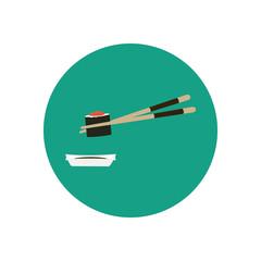 Chopsticks holding sushi with caviar