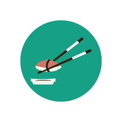 Chopsticks holding sushi with salmon