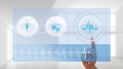 Finger wählt per Interface EKG-Monitor aus