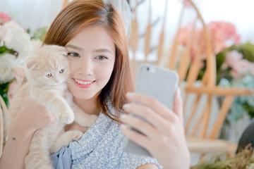 Selfie cat with a cute little girl .