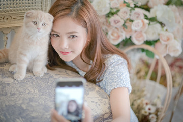 Girl Selfie cat with a cute little girl .