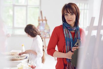 happy satisfied woman artist