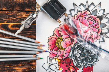 beautiful sketch drawing flowers with colored pencils lying on old wooden background