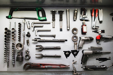 Professional mechanical tools in modern auto service. Set of different instruments in big workshop