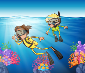 Two people scuba diving under the ocean