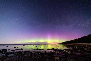 Intense northern lights (Aurora borealis) over Baltic sea