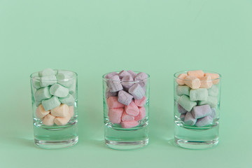 Sweets in glasses on pastel background. Fashion style Minimalism Set. Flat lay, Top view.