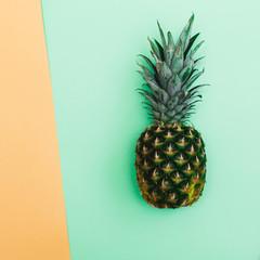 Pineapple on green and orange background. Minimal and stylish.