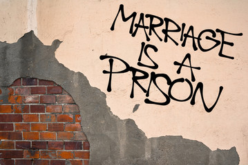 Marriage Is A Prison - Handwritten graffiti sprayed on the wall, anarchist aesthetics - marriage as patriarchal and oppressive institution based on dependency, oppression, monogamy, submission