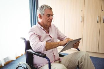 Senior using a tablet in a wheelchair