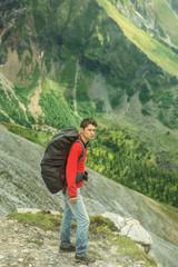 man climbs a mountain at the beautiful view